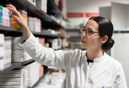 Pharmacy Technician grabbing high-value drugs