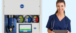 Female clinician standing next to delivery management station