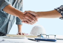 Pevco experts shaking hands, hospital blueprints
