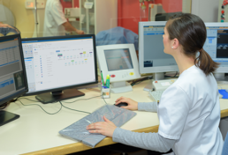 medical technician looking at Pevco software