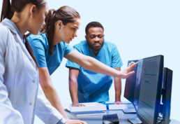 Medical staff viewing Pevco software on a computer screen