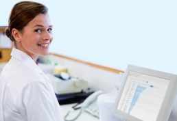 Female medical technician reviewing at Pevco software